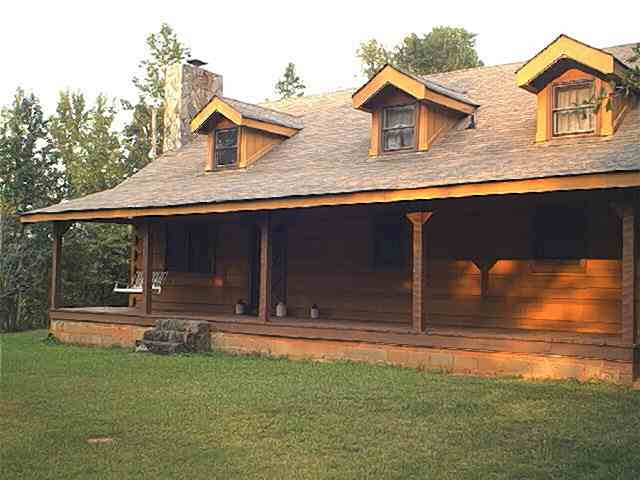 Photo of Hearthstone log home, view from front